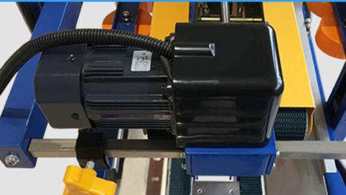 top-bottom driven carton sealer